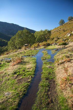 river at gredos mountains in avila spain photo