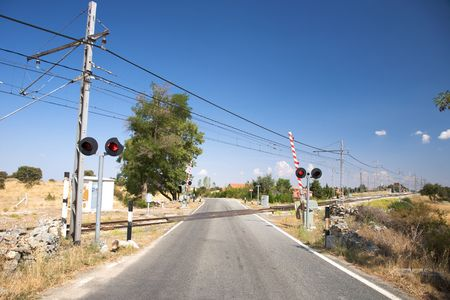 wood railroad: rural level crossing next to segovia city in spain