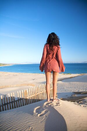 adult footprint: woman at sand dune in spain with african horizon