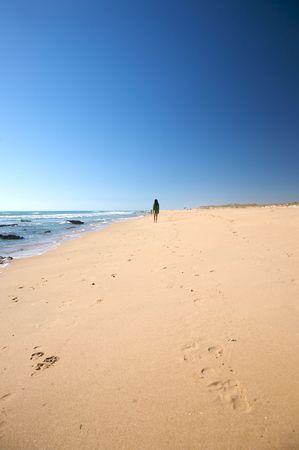 woman at beach of palmar in cadiz spain photo