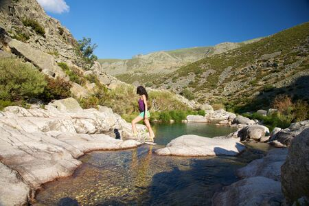 woman on a river at Gredos mountains in Avila Spain photo