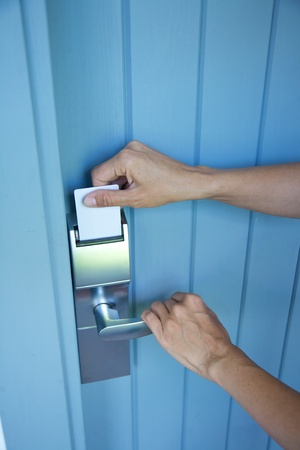 metal lock-card and handle on blue wood door photo