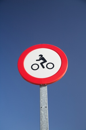 motorbikes forbidden red circle traffic sign at Spain photo