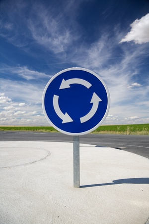 roundabout: roundabout blue signal in a road at Arevalo Spain Stock Photo