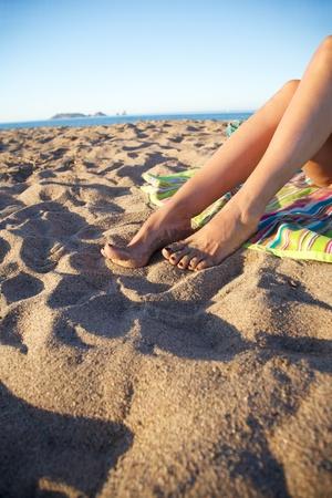woman feet on sand at Girona Catalonia Spain photo