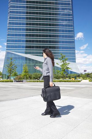 business woman next to skyscrapers in Madrid city Spain photo