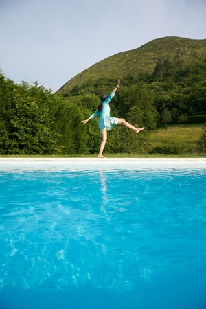 woman barefoot at swimming pool border in Asturias Spain photo