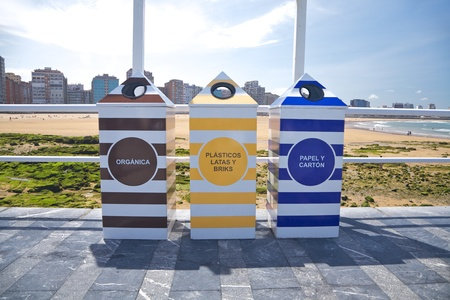 recycling deposits at public promenade in Gijon Asturias Spain photo