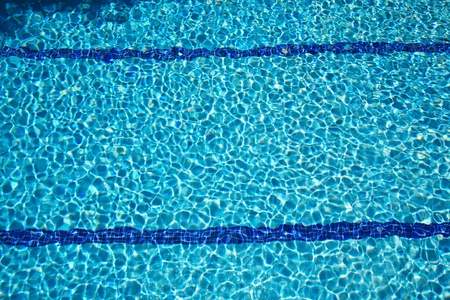 fund: bottom of swimming pool with blue transparent water Stock Photo