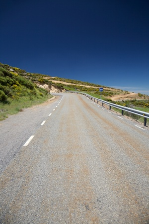 thirty���s: rural road at Gredos mountains in Avila Spain