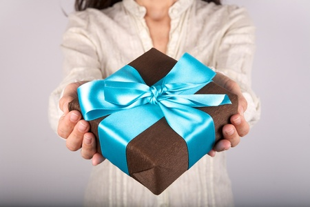 woman detail with a gift box in her hands Stock Photo