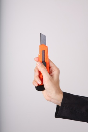 woman hand detail holding an orange cutter Stock Photo - 12894168