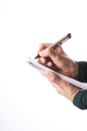 woman detail with a pen writing on a notebook Stock Photo - 12894163