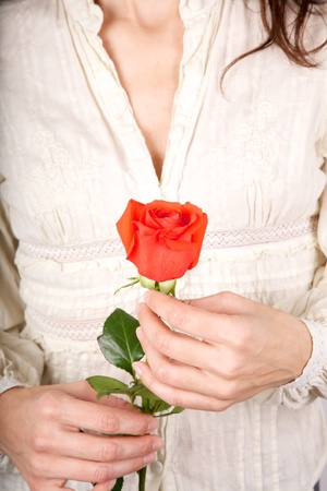 woman detail with a flower in her hands Stock Photo - 12894192