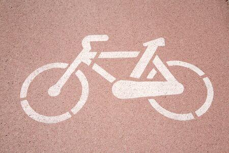 bikers lane sign on the asphalt ground photo