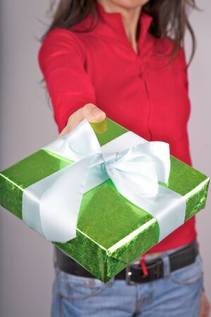zip tie: woman detail with a gift box in her hands Stock Photo