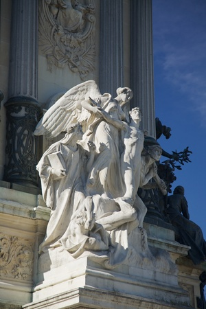 antique sculpture of 1922 at El Retiro public park in Madrid Spain photo