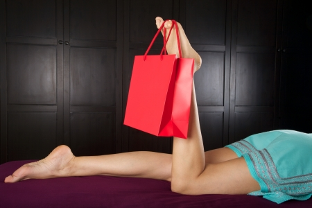 shopping bag holding by woman finger foot photo