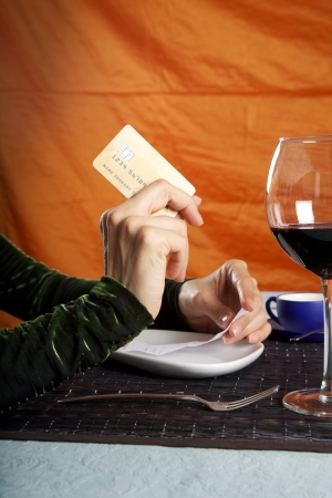 woman hand paying with credit card at restaurant photo