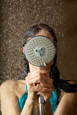 woman taking a shower under water jet  photo