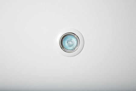 circular floodlight with blue halogen in white roof photo