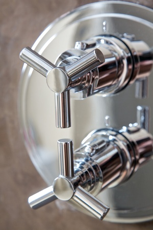 hand shower equipment on brown wall of bathroom Stock Photo - 15499179