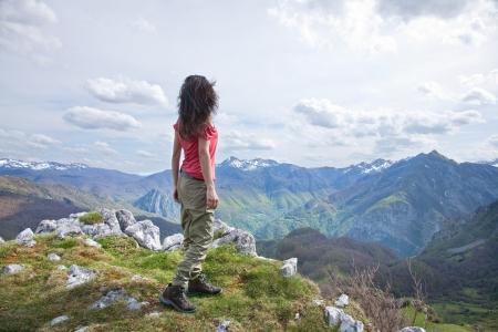 picos: woman trekking at Picos de Europa mountains in Asturias Stock Photo