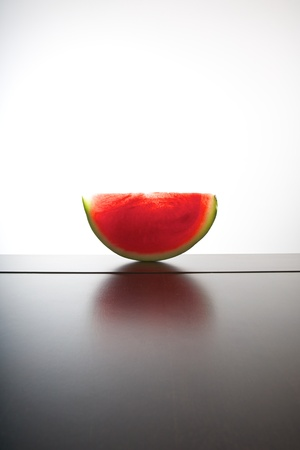 still life watermelon on wood table and white background photo