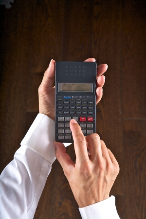 hand detail with a scientific calculator in her hands photo