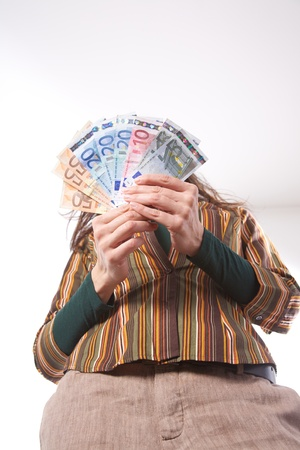 10 fingers: woman detail with group of Euro bills in her hands