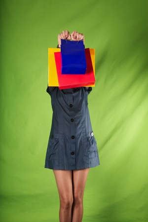 woman detail holding shopping bags on green background Stock Photo - 16029917