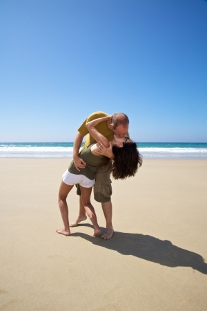 kissing couple at sandy beach in Cadiz Andalusia Spain photo
