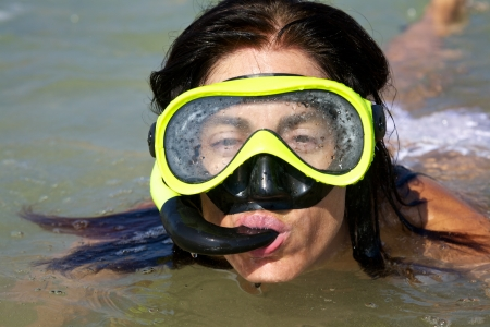 skin diving: woman at sandy beach in Cadiz Andalusia Spain Stock Photo