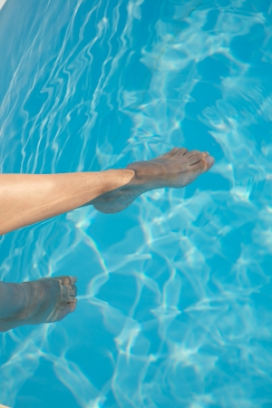 woman barefoot at swimming pool in Asturias Spain photo