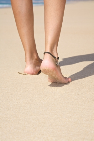 ankle strap: woman at sandy beach in Cadiz Andalusia Spain Stock Photo