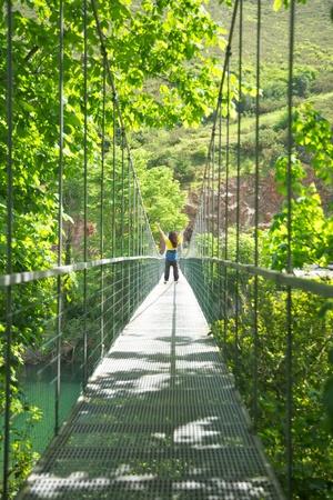 footbridge over Sella river near to Ribadesella village in Asturias Spain photo