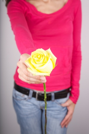 woman detail with a flower in her hands photo