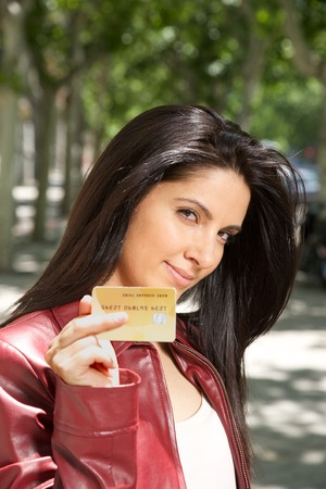 woman with credit card in her hand at street in Madrid city Spain  photo
