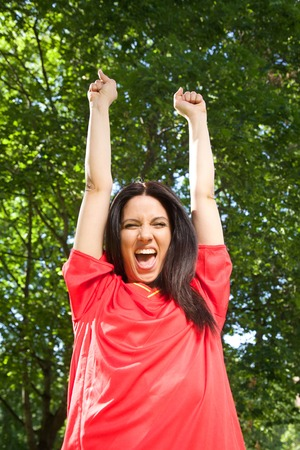woman with spanish football team shirt cheering happy  photo