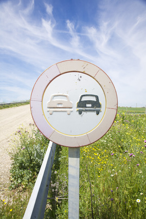 overtake: no overtake old road signal in a landscape from Spain
