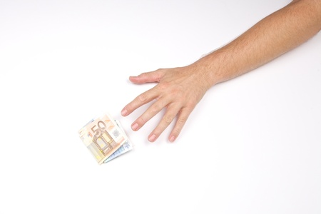 hand of man and wad of euros on white background photo