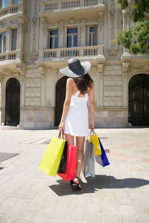 brunette woman with white dress walking in Madrid city Spain photo