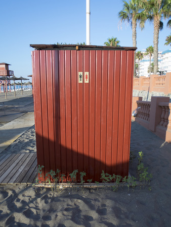 loo: man and woman wc icon on red pattern metal wall in beach of Benalmadena Andalucia Spain