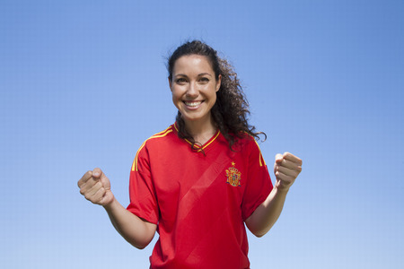 woman with spanish soccer team shirt cheering happy photo