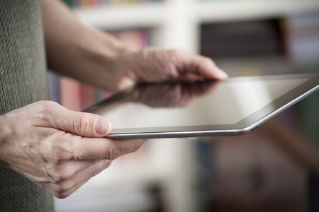 digital learning: blank screen tablet in woman hands with green jersey