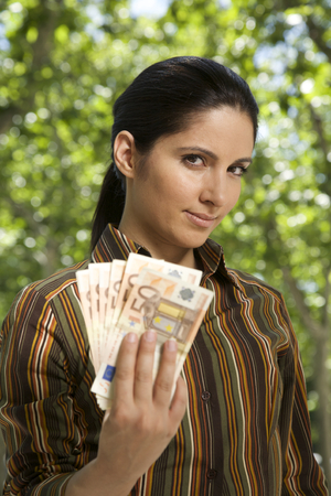 businesswoman with banknote Euros in her hand photo