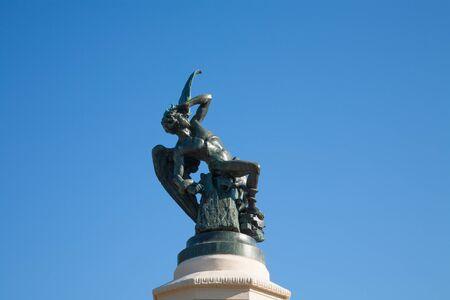 fallen angel: landmark of famous neoclassical sculpture monument of fallen angel in El Retiro Park in Madrid city Spain Europe. Made in year 1877 by Ricardo Bellver artist