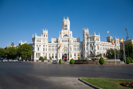 diosa griega: landmark of Cibeles Square in Madrid city Spain Europe with famous neoclassical sculpture monument fountain of greek goddess and facade of public town hall building, and traffic in the street