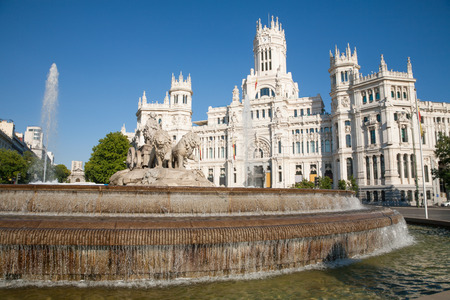 diosa griega: landmark of famous neoclassical sculpture monument fountain of greek goddess Cibeles in Madrid city Spain Europe, facade of public town hall building. Made in year 1782 by Ventura Rodriguez artist