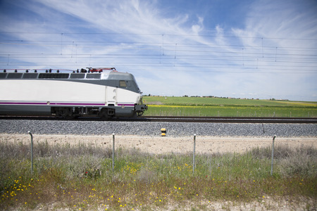 high speed train: profile of locomotive high speed train in a landscape from Spain